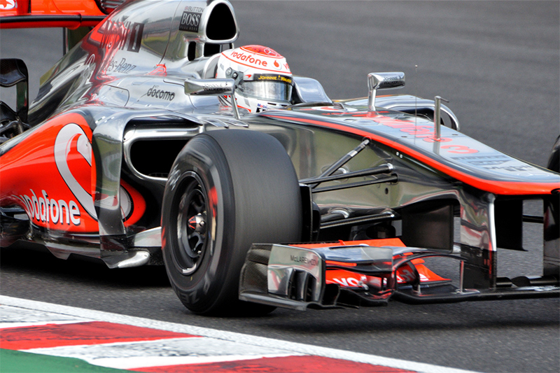 Jenson Button as he exits the hairpin in Japan 2012. credit: Michael Elleray